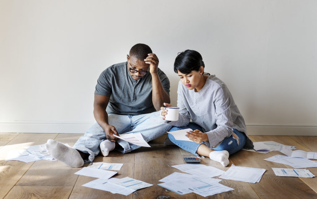 couple evaluating debt in distress