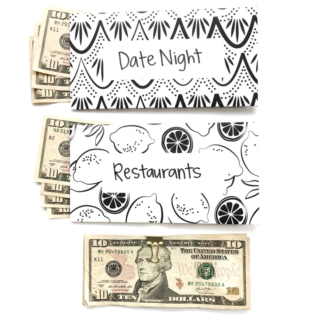 black and white cash envelopes with money