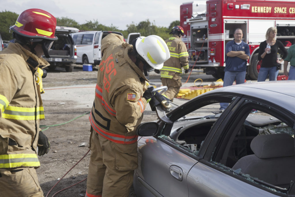firefighters opening a car