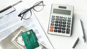credit card, money, and a calculator on a desk mockup