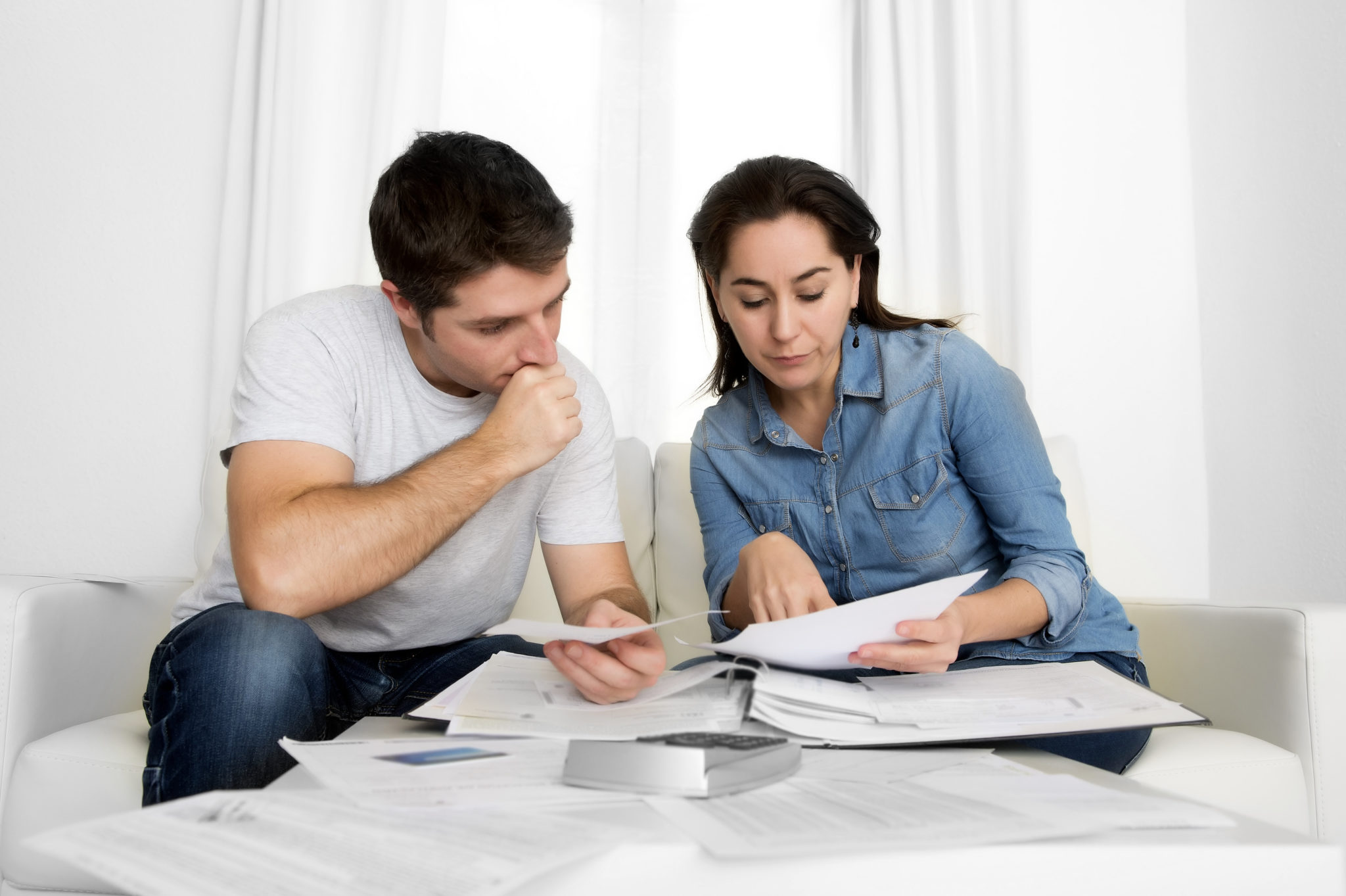 young couple stressing over bad financial situation