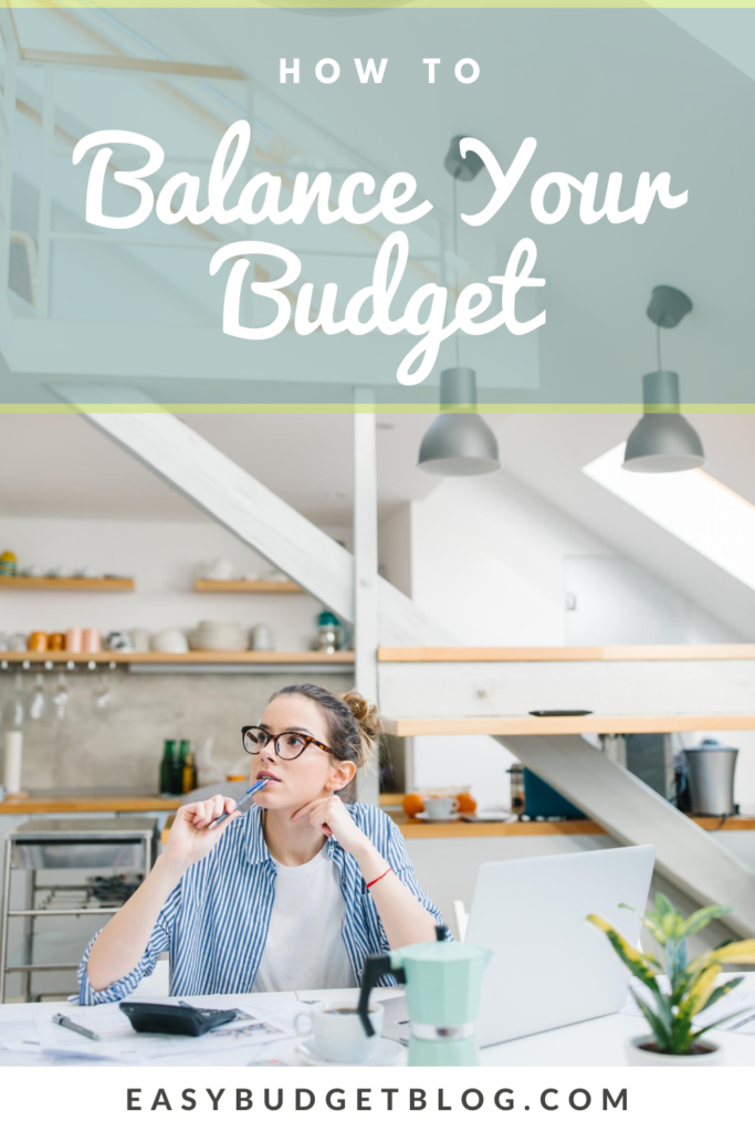 woman in modern kitchen doing a budget pin image
