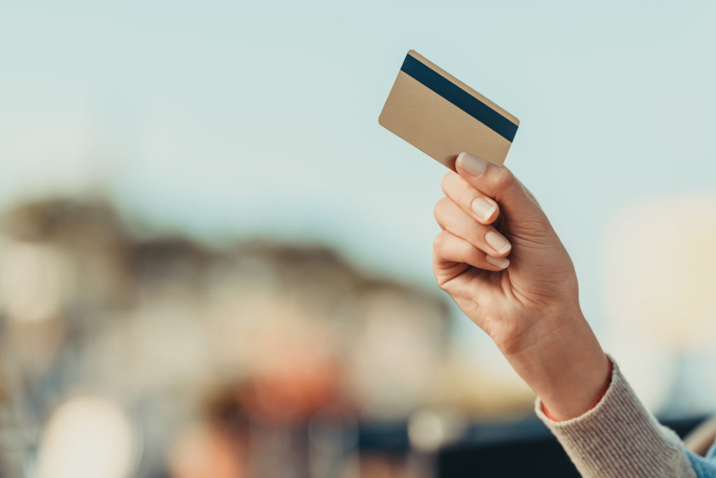 woman's hand holding credit card